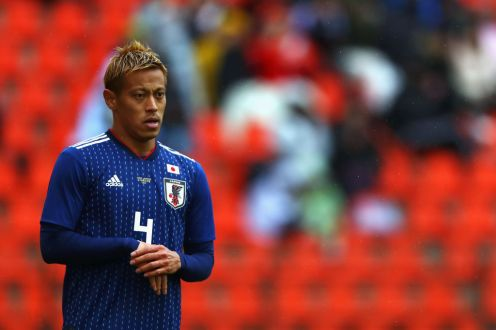 LIEGE, BELGIUM - MARCH 27: Keisuke Honda of Japan in action during the International friendly match between Japan and Ukraine held at Stade Maurice Dufrasne on March 27, 2018 in Liege, Belgium. (Photo by Dean Mouhtaropoulos/Getty Images)